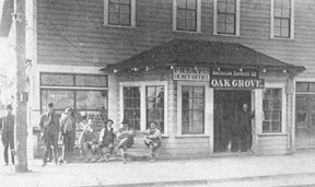 Old photograph showing men waiting in front of the Oak Grove trolley station.
